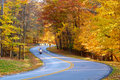 Autumn road with biker Stock Photography