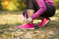 Autumn runner close up of feet of a running in leaves training exercise Stock Photos