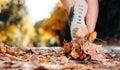 Autumn runner feet Royalty Free Stock Photo