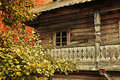 Autumn rural landscape small house among the trees wooden yellowed in cloudy weather vintage and tonal correction processing Stock Photography