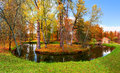 Autumn rural landscape solitude island with pond and small house on the background colorful Royalty Free Stock Images