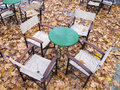 Autumn scene deserted cafe table in Royalty Free Stock Images