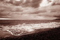 Autumn seascape with waves and shoreline retro style sepia Royalty Free Stock Image