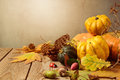 Autumn season background with fall leaves and pumpkin on wooden table Royalty Free Stock Photo