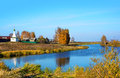 Autumn season in village of kostromskya region chapel on river Stock Photography