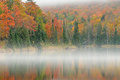 Autumn shoreline alberta lake in fog michigan s upper peninsula usa Stock Image