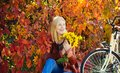 Autumn simple pleasures. Girl ride bicycle for fun. Blonde enjoy relax park. Autumn bouquet. Warm autumn. Girl with Royalty Free Stock Photo