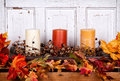 Autumn still life with candles and leaves Stock Photos