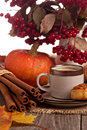 Autumn still life with coffee cinnamon and pumpkin Royalty Free Stock Photo