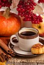 Autumn still life with coffee cinnamon and pumpkin Royalty Free Stock Photography