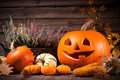 Autumn still life with halloween pumpkins on old wooden background Royalty Free Stock Image