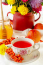 Autumn still life sea buckthorn tea honey and flowers Stock Images