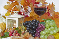 Autumn still life with various fruits and a lantern Stock Photos