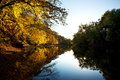 Autumn sunset along the river Royalty Free Stock Photo