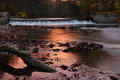Autumn sunset over the river and weir waterfall called viktorcin splav in babiccino udoli grandmas valley czech republic Stock Image