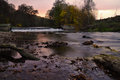 Autumn sunset over the river and weir waterfall called viktorcin splav in babiccino udoli grandmas valley czech republic Royalty Free Stock Photo