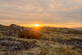 Autumn sunset in the tundra.The rays of the sun illuminate a large stone. Royalty Free Stock Photo