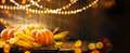 Autumn Thanksgiving pumpkins over wooden background Royalty Free Stock Photo