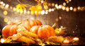 Autumn Thanksgiving pumpkins over wooden background