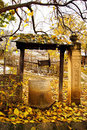 Autumn time: old stone well with yellow leaves Royalty Free Stock Images