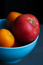 Autumn tomatoes in blue bowl red and yellow Stock Photography