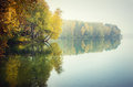Autumn trees reflecting on lake scenic view of luokesai moletai lithuania Stock Photo