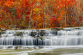 Autumn at upper cataract falls whitewater pours over rock ledges indiana s with beautiful colorful fall foliage Royalty Free Stock Image