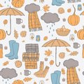 Autumn vector pattern with umbrella, rubber boots and leaves