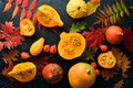 Autumn vegetables. Pumpkin with pumpkin seeds and autumn leaves. flat lay. On a black stone background. Top view.