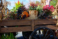 Autumn wagon filled with decorative plants a wooden cornstalk and pumpkin reflecting the season Royalty Free Stock Photo