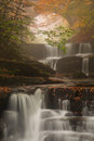 Autumn waterfall a lovely in an forest Royalty Free Stock Images