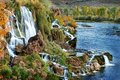 Autumn Waterfall with Orange Leaves Royalty Free Stock Photo