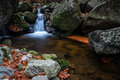 Autumn waterfall with stones in forest Stock Image