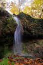 Autumn waterfall a wild small during colors Stock Image