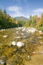 An autumn waterway along the Kancamagus Highway in the White Mountain National Forest, New Hampshire Royalty Free Stock Photo