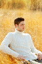 Autumn winter man portrait in outdoor dried grass Stock Images