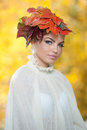 Autumn woman beautiful creative makeup and hair style in outdoor shoot beauty fashion model girl with autumnal make up and hair Royalty Free Stock Image