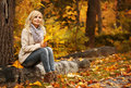 Autumn Woman. Fall. Blonde Beautiful Girl with Yellow Leaves Royalty Free Stock Photo