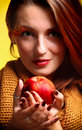 Autumn woman girl glamour eye lashes red apple in sepia fashion female fresh colour Stock Photography