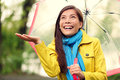 Autumn woman happy after rain walking umbrella with female model looking up at clearing sky joyful on rainy fall day wearing Stock Photos