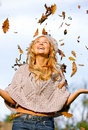 Autumn woman having fun Royalty Free Stock Image