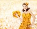 Autumn woman leaves dress, fall season fashion Royalty Free Stock Photo
