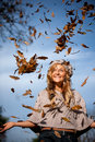 Autumn woman with leaves falling Royalty Free Stock Image