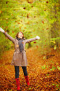 Autumn - Woman playing with leaves in the forest Stock Photos