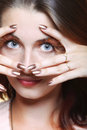 Autumn woman stylish creative make up false eye lashes fashion female long brown autumnal colour girl framing her face with hands Royalty Free Stock Photo