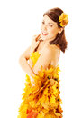 Autumn woman in yellow dress of maple leaves Royalty Free Stock Photo