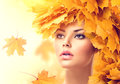 Autumn woman with yellow leaves hairstyle fall creative makeup Royalty Free Stock Images