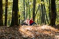 Autumn women talking on mobile phone in fall. Two serious girls having smartphone conversation. Royalty Free Stock Photo