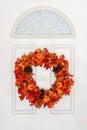 Autumn Wreath Hanging on White Door Royalty Free Stock Photo