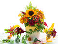 Autumnal flowers in vases on the table Stock Image